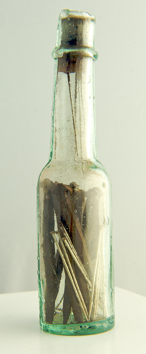 Securely corked witch bottle collected by Clarke containing nine new steel pins, needles and iron nails. Bellarmine bottles were sometimes used and also contained urine, hair and fingernail clippings of the person who had been bewitched ©Scarborough Museums Trust Photographer: David Chalmers