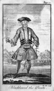 "Blackbeard, by Engraved by Benjamin Cole[1] (1695–1766) - Defoe, Daniel; Johnson, Charles (1724) ""Capt. Teach alias Black-Beard"" in A General History of the Pyrates: From Their First Rise and Settlement in the Island of Providence, to the Present Time. With the Remarkable Actions and Adventures of the Two Female Pyrates Mary Read and Anne Bonny. To Which is Added. A Short Abstract of the Statute and Civil Law, in Relation to Pyracy. (Second Edition ed.), London: T. Warner, pp. plate facing p. 70 Retrieved on 8 April 2010., Public Domain, https://commons.wikimedia.org/w/index.php?curid=10112479"