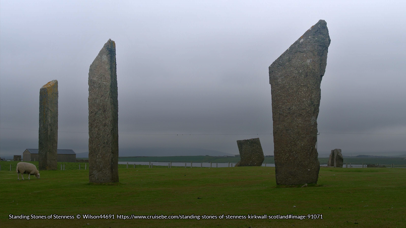 Photograph of the standing stones of Stennes in Orkney, with a sheep eating grass.