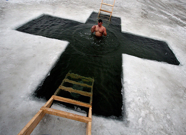 An ice hole is cut in the form of a cross in Russia to celebrate the Epiphany. By RIA Novosti archive, image #550903 / Vitaliy Ankov / CC-BY-SA 3.0, CC BY-SA 3.0, https://commons.wikimedia.org/w/index.php?curid=18132146