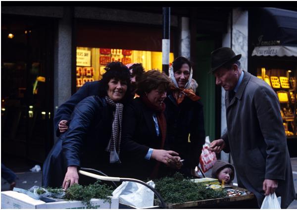 Shamrock sellers on St Patrick's Day, Henry Street, Dublin (1980). Photographer: Bróna Nic Amhlaoibh[8]