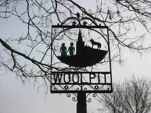 "The ""green children"" of Woolpit on the village sign. By Rod Bacon, CC BY-SA 2.0, https://commons.wikimedia.org/w/index.php?curid=13883142"