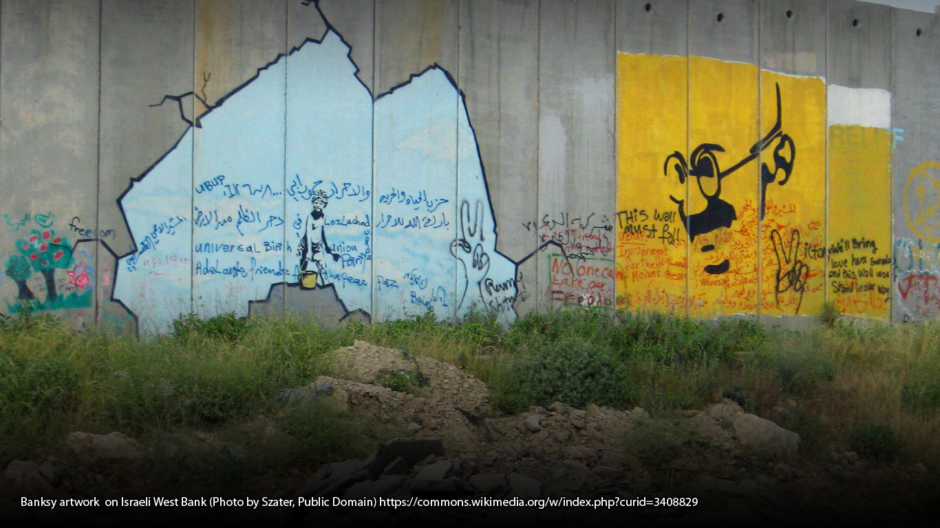 Banksy artwork on Israeli West Bank (Photo by Szater, Public Domain) https://commons.wikimedia.org/w/index.php?curid=3408829