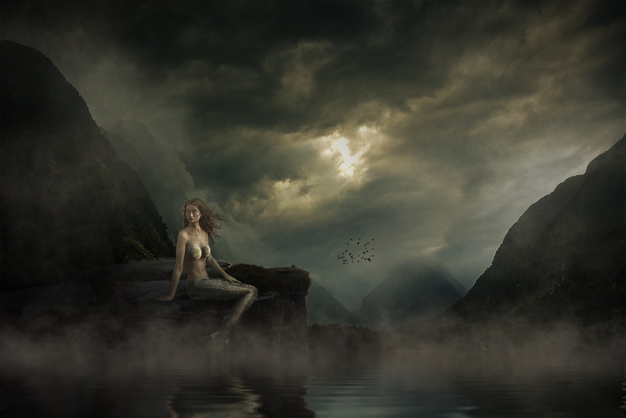 mermaid sitting on a rock surrounded by mist