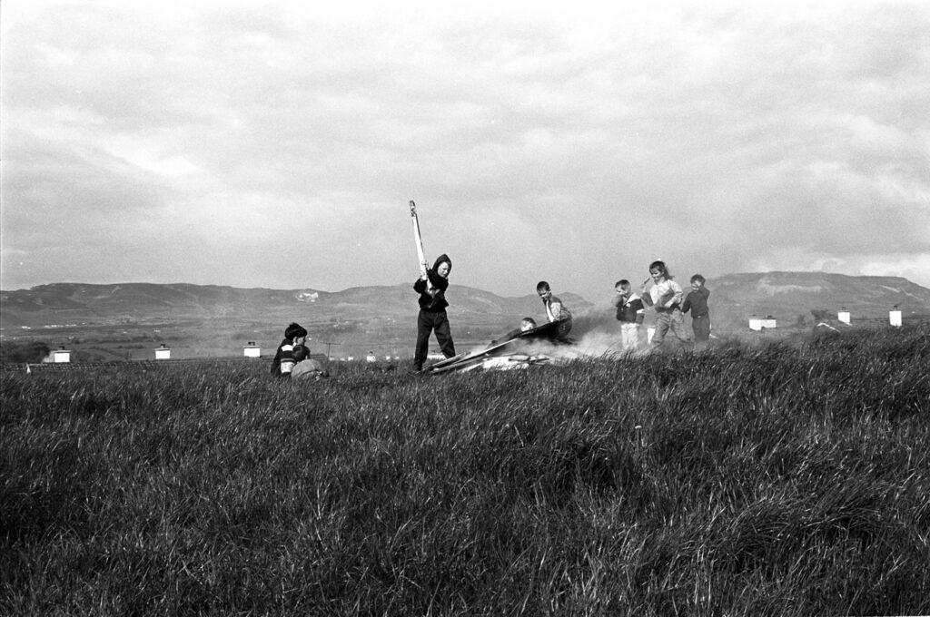 Children sitting around a May Day bonfire, Sligo (May 1993). Photographer: Bairbre Ní Fhloinn. Source https://www.duchas.ie/en/cbeg/46814
