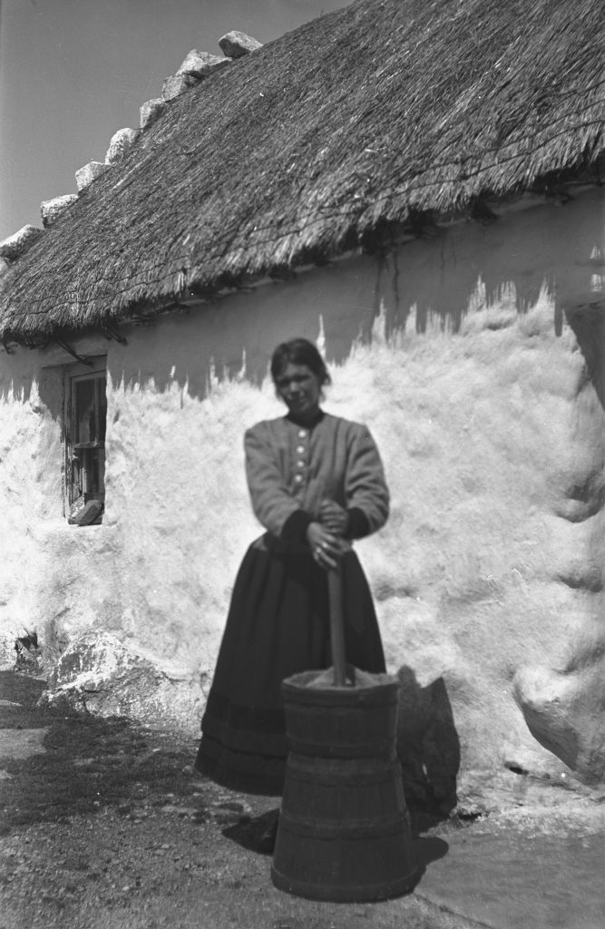 Woman churning, Garmna, Galway (1935). Photographer: Åke Campbell. Source https://www.duchas.ie/en/cbeg/16352