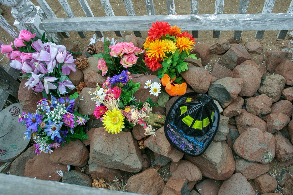 Figure 5. Objects left on Bulette's imagined grave. In addition, a nearby tree often has objects left hanging there. Photograph by Ronald M James.