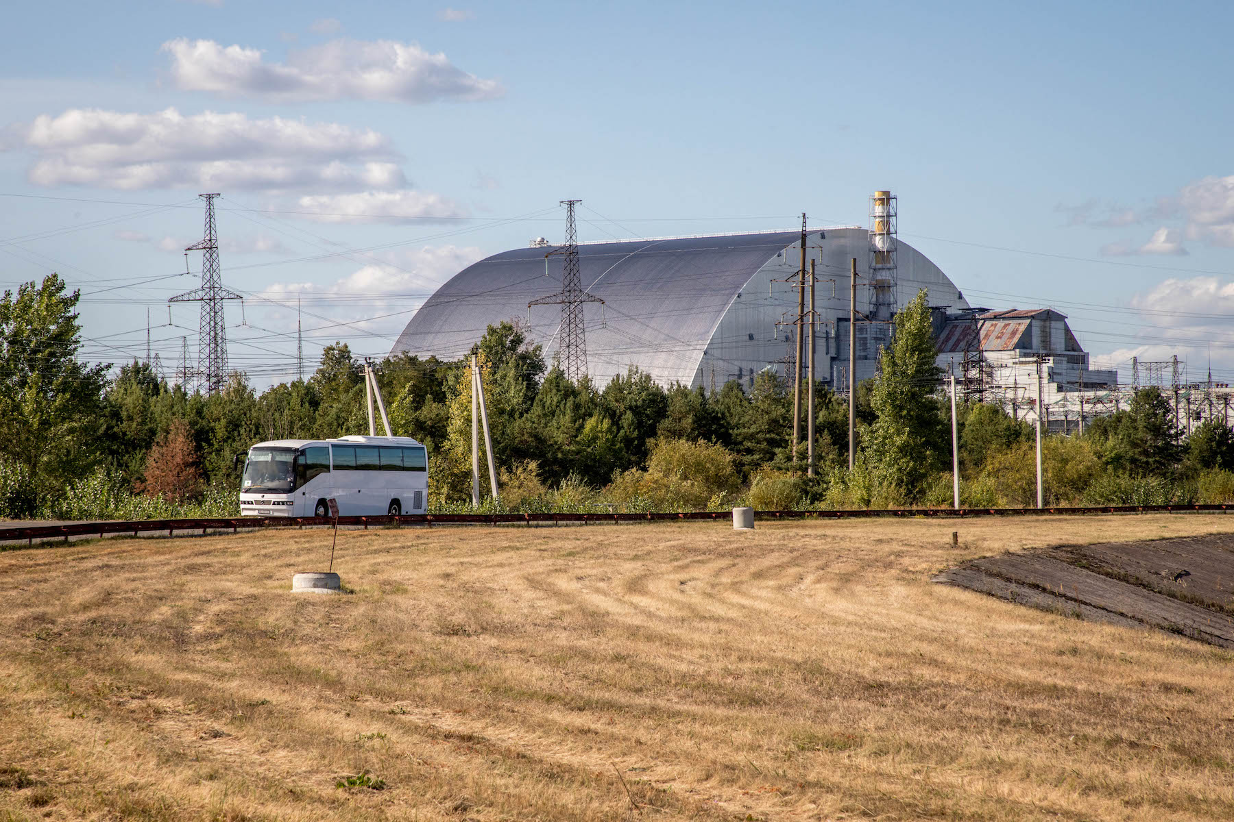 The New Safe Confinement structure installed over the destroyed Reactor 4 at the Chernobyl Nuclear Power Plant. A barrow of the Atomic Age, it will dominate this landscape for a hundred years to come. © Darmon Richter